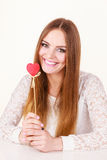 Beautiful woman holding heart shaped hand stick Stock Images