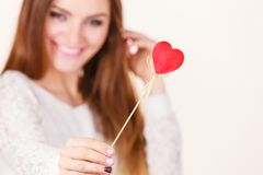 Beautiful woman holding heart shaped hand stick Stock Photos