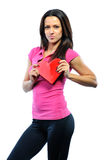 Beautiful woman holding heart and smiling to you - isolated on w Stock Photography