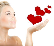 Beautiful woman holding hearts Royalty Free Stock Photo