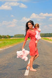 Beautiful woman holding her daughter Stock Image
