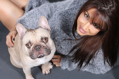 Beautiful woman holding her dog . A lovely French Bulldog Stock Photo