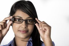 Beautiful woman holding  her frame glasses Royalty Free Stock Photography