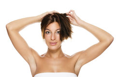 Beautiful woman holding her hair Royalty Free Stock Images