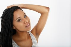 Beautiful woman holding her hair with hand. Against white background Stock Images