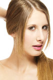 Beautiful woman holding her hair to a pigtail Royalty Free Stock Photo
