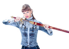 Beautiful  woman holding in her hands a sword Stock Image