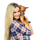 Beautiful woman holding her little puppy dog over white backgrou Stock Photos