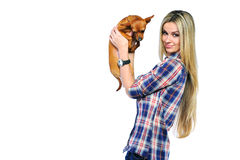 Beautiful woman holding her little puppy near a copyspace and lo Royalty Free Stock Photo