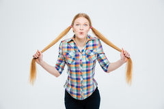 Beautiful woman holding her ponytail Stock Photography