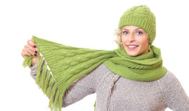 Beautiful woman holding her scarf and wearing warmly cap Stock Photo