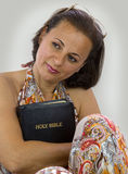 Beautiful woman holding holy bible Stock Images