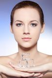 Beautiful woman holding ice Stock Images