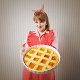 Beautiful woman holding italian pie. Stock Images