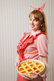 Beautiful woman holding italian pie. Royalty Free Stock Image