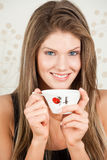 Beautiful woman holding a Japan cup of a tea Royalty Free Stock Images