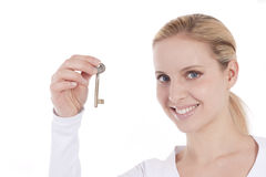 Beautiful woman holding key. Beautiful young woman holding key; concepts: new house/young people and house Stock Photo