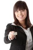 Beautiful woman holding keys and moneys Royalty Free Stock Photography