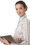 The beautiful woman holding laptop. Portrait on a white background of the young, smiling woman holding laptop Stock Photography
