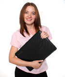 Beautiful woman holding a laptop Stock Images