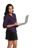 Beautiful Woman Holding Laptop. Beautiful businesswoman holding laptop isolated over white background royalty free stock images