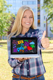 Beautiful woman holding laptop with colorful media icons and app. Lications and thumbs up in autumn park Royalty Free Stock Image