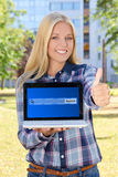 Beautiful woman holding laptop with search bar on screen and thu Royalty Free Stock Images
