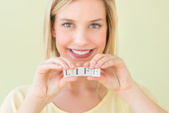 Beautiful Woman Holding Letter Blocks Reading Life Stock Photo