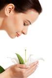 Beautiful woman holding lily flower. Stock Photo