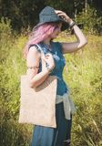 Beautiful woman holding linen bag in summer field. Template mock Stock Images