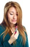 Beautiful woman holding lipstick Stock Images