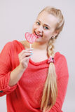 Beautiful woman holding a lollipop Stock Images