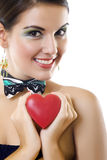 Beautiful woman holding a love symbol in hands Stock Photography