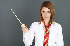 Beautiful woman holding a magic wand stock images