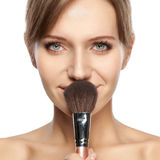 Beautiful woman holding makeup brush Royalty Free Stock Photography
