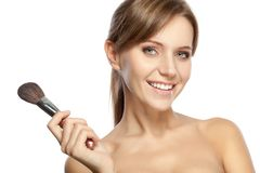 Beautiful woman holding makeup brush Royalty Free Stock Image