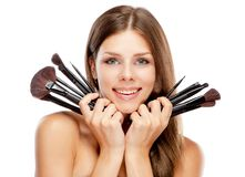 Beautiful woman holding makeup brushes Stock Photo