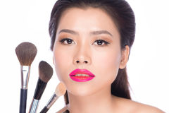 Beautiful woman holding makeup brushes set Royalty Free Stock Image