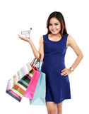 Beautiful woman holding many shopping bags and shopping chart Stock Images