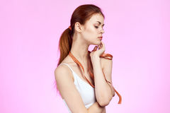 Beautiful woman holding a measuring tape stock photography