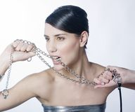 Beautiful woman holding metallic chain Royalty Free Stock Image