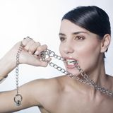 Beautiful woman holding metallic chain Royalty Free Stock Photography