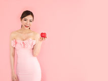 Beautiful woman holding mini heart on hand,fashion girl on pink stock images
