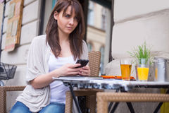 Beautiful woman  holding mobile. Royalty Free Stock Images