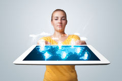 Beautiful woman holding modern tablet with social icons Stock Photos