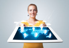 Beautiful woman holding modern tablet with social icons Stock Photography