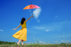 Beautiful woman holding multicolored umbrella Royalty Free Stock Photo