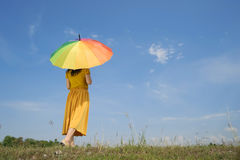 Beautiful woman holding multicolored umbrella and blue sky. Vacation summer concept Royalty Free Stock Photo