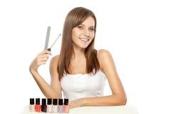 Beautiful woman holding nail file Stock Photo