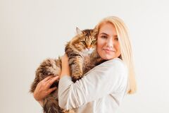 Free Beautiful Woman Holding New Adopted Fluffy Cat With Green Eyes Stock Image - 172395321